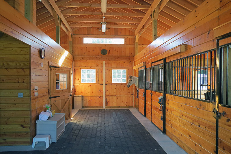 Inside this Modular Horse Barn.  Center aisle and stall fronts.